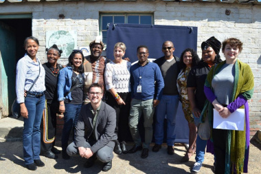 Minister Anroux Marais with staff members from HWC and Museum Service who worked on the project