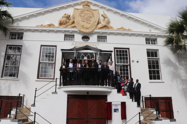 Minister Anroux Marais with stakeholders at the impressive facade of the Old Granary Complex