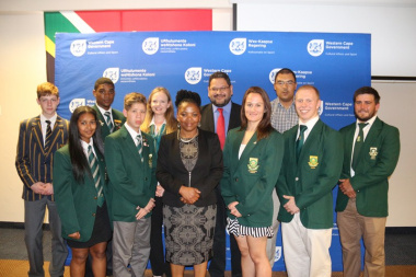 Minister Mbombo and HOD Walters with some of the athletes who were honoured