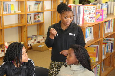 Minister Mbombo and learners discuss Madiba poetry and books