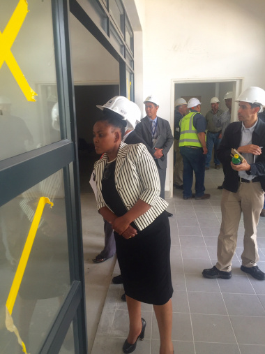 Minister Mbombo inspects the courtyard at the site of the new psych building at Paarl Hospital.
