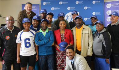 Minister Mbombo with DCAS Sport Development Staff and the team captains.