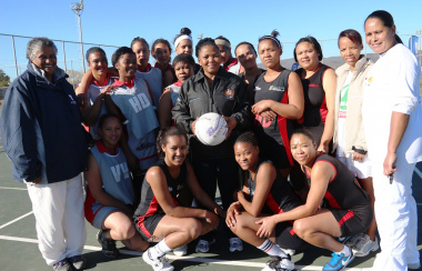 Minister Mbombo with netball players and representatives at the Oudtshoorn Sport Festival.