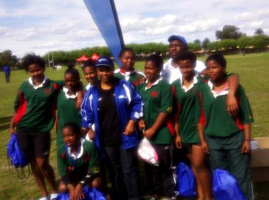 Minister Mbombo with the Busy Bees U18 team.