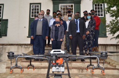 Minister Meyer, HOD Dr Mogale Sebopetsa with group of drone pilots