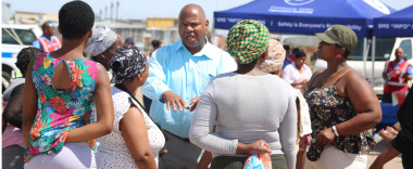 Minister of Community Safety, Dan Plato engages a group of women from Marikana informal settlement who attended the 16 days of Activism Launch.