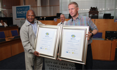 Minister Plato and Alderman JPSmith: Mayoral Committee Member forSafety, Security and Social Services stand with the signed MOA.
