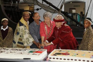 Mossel Bay Executive Mayor, Alderlady Ferreira, proceeds to cut the cake at the celebrations