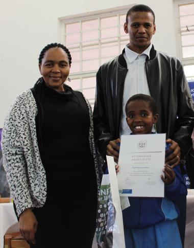 Most Promising Reader Phethokuhle Lobese of Ludwe Ngamlana Primary School with Xolisa Tshongolo and Beaulla Stofile of DCAS.