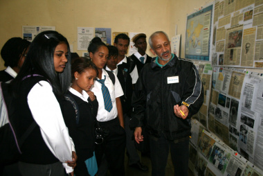Mr Ebrahim Manuel with learners at the exhibition on research methods and archival resources.