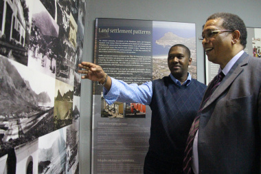 Mr Jerome Abrahams shows Dr Ivan Meyer one of the displays.