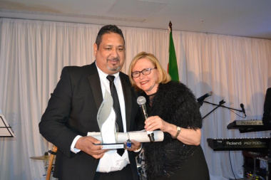 Mr Shaun Julie receives his award from Premier Helen Zille