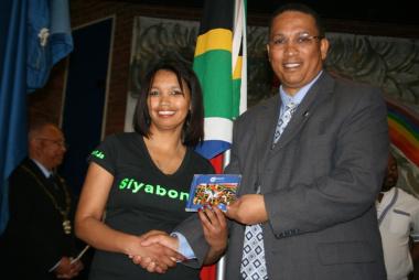 Ms Chrizelda Saul (Siyabonga Care Village) and Dr Ivan Meyer at the National CD handover ceremony.