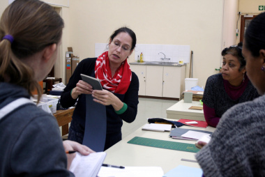 Ms Mary Manicka explains the art of making paste papers at the workshop.