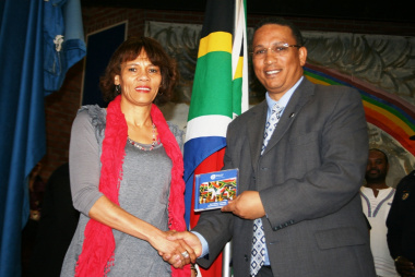 Ms Ronel Beukes (Department of Education) and Dr Ivan Meyer at the National Anthem CD handover ceremony.