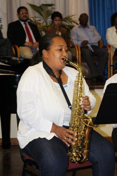 Music Development Programme student Angeline Constant entertains guests.