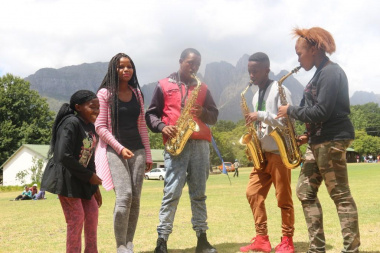Mvume Gobelo (centre) jams with his friends from Langa High School