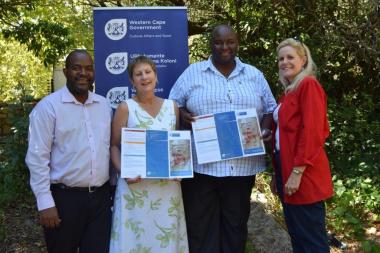 Mxolisi Dlamuka, Minister Marais, Prof Mawande Diali and Anita van der Merwe proudly presenting the Khoekhoe geographical names brochure