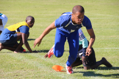 Nande Mhlomi from Mbekweni in hot pursuit in a game of Kho-Kho at the Cape Winelands Indigenous Games .