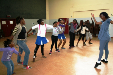 Nandipha Sandlana dancing with the female participants during a workshop.