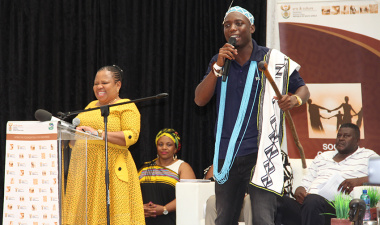 National Deputy Minister of Arts and Culture, Makhotso Sotyu (left), is introduced by a praise singer in Khayelitsha on Friday.