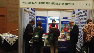 Neville Adonis and Director Archive Services Nikiwe Momoti engaging at the exhibition stand