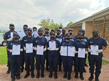 new_recruits_standing_proudly_with_their_certificates_robertson.jpeg