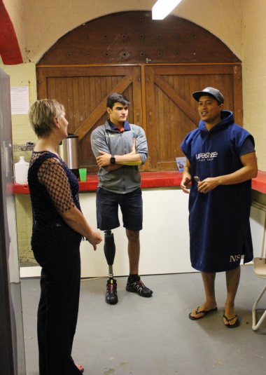 Nigel Savel founder of the 9Miles project giving Minister Anroux Marais and Caleb Swanepoel a tour of their club house at Strandfontein Pavilion.