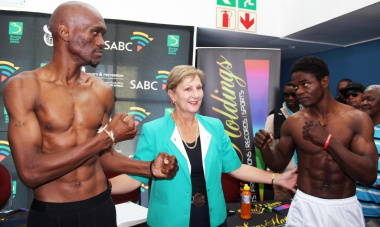 Nkuleleko Mhlongo and Christiano Ndombussy participating in the main bout for the WBA Pan African Title with Minister Marais.
