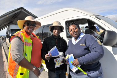 Nonkosi Peter and Sergeant Abegail Jacobs pose with taxi driver Benedict Maqanda.