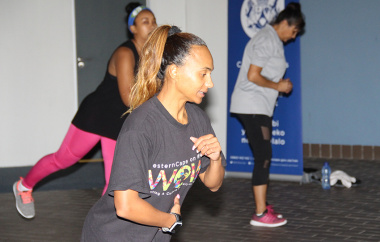 Olivia Carolisen, a Western Cape Government gym instructor, leads the aerobics class.