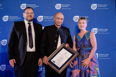 Omar Badsha receives his ministerial commendation from Minister Anroux Marais and HOD Brent Walters at the annual Cultural Affairs Awards Ceremony in Cape Town