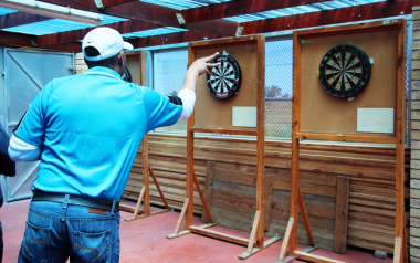 On target during a games of darts with a participant of the Western Cape Gambling and Racing Board.