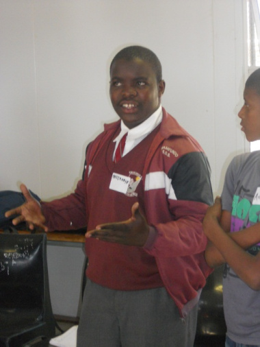 One of the learners performs praise singing during a workshop.