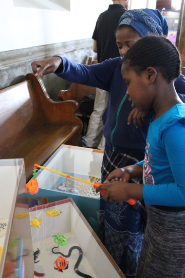 One of the learners shows her friend how to play fish