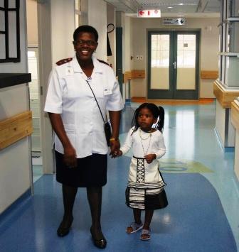 Operational manager Sr Lindiwe Teto gives patient Lindokuhle Dlakavu a tour of the newly opened Ward B2.