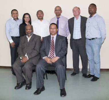 Oudtshoorn Administrator, Kam Chetty, Minister Meyer flanked by officials