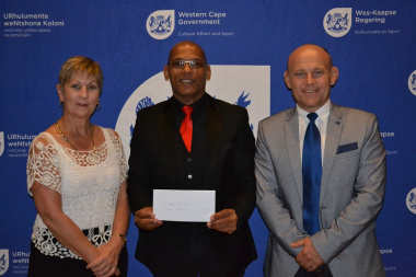 Overberg Sport Council Chairperson Rudolph Johannes received their cheque from Minister Anroux Marais