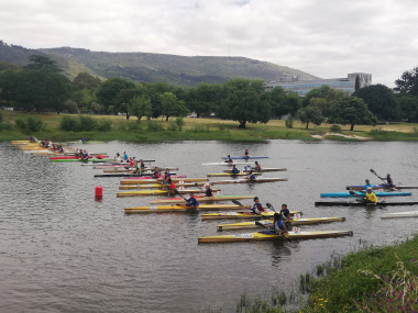 Paddlers line up at the start of the race.
