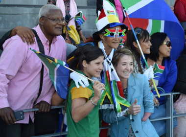 Paralympian athletes Ilse Carstens and Anrune Liebenberg with the crowd at the Green Point Stadium