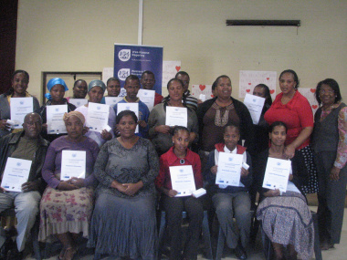Parents and community members who received certificates with facilitators, teachers and DCAS staff.