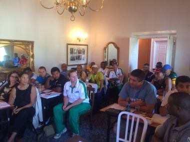 Participants at the worshop attentively listen on how to improve their coaching skills and techniques