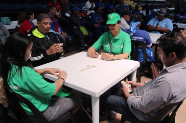 Participants from Community Safety concentrating intensely during a game of dominoes.