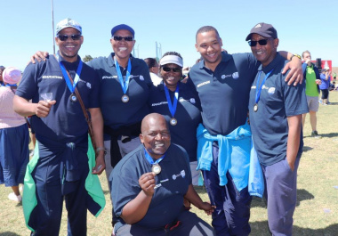 Participants from the Western Cape Education Department showing off their medals after the fun run and walk.