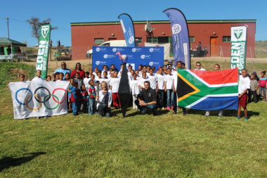 Participants light the Olympic torch in Van Wyksdorp