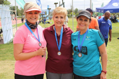 Participants showing off their medals after the Trail Walk