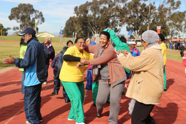 Participants take part in an impromptu dance to warm up for the games.
