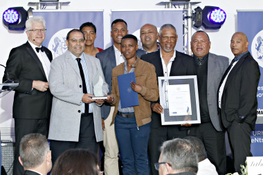 Paul Hendricks (second from left) accepts one of the awards from Premier Alan Winde (first from left) on Wednesday night