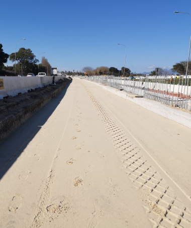 Phase 2 median widening and installation of the concrete median barrier.