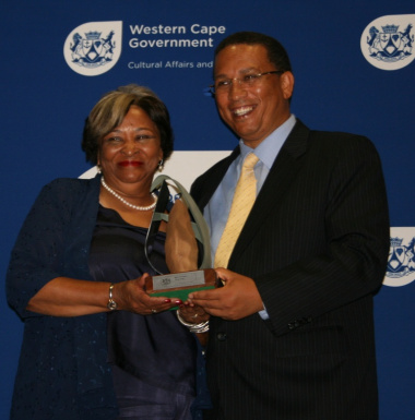 Phoebe Abrahams receive her late husband Prof Jakes Gerwel's award for Lifetime Achievement.
